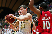 SHOT 1/28/12 4:20:46 PM - Colorado State's Jesse Carr #11 grabs a rebound in front of San Diego State's Tim Shelton #10 during their regular season Mountain West conference game at Moby Arena in Fort Collins, Co. Colorado State upset 12th ranked San Diego State 77-60. (Photo by Marc Piscotty / © 2012)