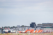 Easyjet and British Airways aircraft fleet are seen parked up in Gatwick airport on Monday, June 29, 2020. Gatwick Airport is getting ready for more holiday bookings after the Government agreed to open-air corridors to a number of countries a few days after Britain lifted most of the lockdown rules in England. (Photo/ Vudi Xhymshiti)