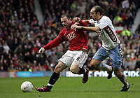 Photo: Paul Thomas.<br /> Manchester United v Aston Villa. The FA Cup. 07/01/2007.<br /> <br /> Wayne Rooney (L) of Man utd battles with Gavin McCann.