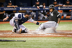 June 8, 2017 - St. Petersburg, Florida, U.S. - WILL VRAGOVIC       Times.Tampa Bay Rays catcher Derek Norris (33) tags Chicago White Sox left fielder Willy Garcia (61) as he attempts to score after advancing on his double to third on the throwing error by Tampa Bay Rays center fielder Kevin Kiermaier (39) in the third inning of the game between the Tampa Bay Rays and the Chicago White Sox at Tropicana Field in St. Petersburg, Fla. on Thursday, June 8, 2017. (Credit Image: © Will Vragovic/Tampa Bay Times via ZUMA Wire)
