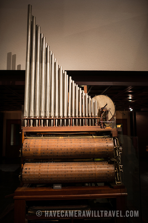 A cross between a pionala and a pipe organ on display at the Musical Instrument Museum in Brussels. The Musee des Instruments de Musique (Musical Instrument Museum) in Brussels contains exhibits containing more than 2000 musical instruments. Displays include historical, exotic, and traditional cultural instruments from around the world. Visitors to the museum are given handheld audio guides that play musical demonstrations of many of the instruments. The museum is housed in the distinctive Old England Building.