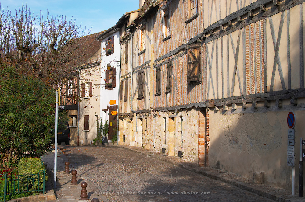 A cobble stone street and old cross beam half timber and stone houses in the Old Town. on Place de la Myrpe, facing Place du Docteur Cayla Square Bergerac Dordogne France