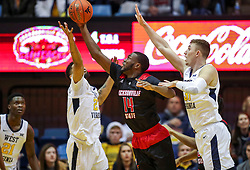 Dec 22, 2018; Morgantown, WV, USA; Jacksonville State Gamecocks forward Jason Burnell (14) and West Virginia Mountaineers forward Esa Ahmad (23) jump for a rebound during the first half at WVU Coliseum. Mandatory Credit: Ben Queen-USA TODAY Sports