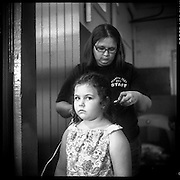 Mother fixing her daughters hair for the  Redneck Festival contest, Baxterville, Mississippi
