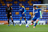 AFC Wimbledon midfielder Alex Woodyard (4) passing the ball during the EFL Sky Bet League 1 match between AFC Wimbledon and Lincoln City at Plough Lane, London, United Kingdom on 2 January 2021.
