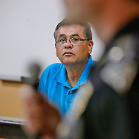 Thoreau Chapter House president Lester Emerson listens as Caption of New Mexico State Police, Eric Schum, answer questions from attendee of a forum on Public safety.