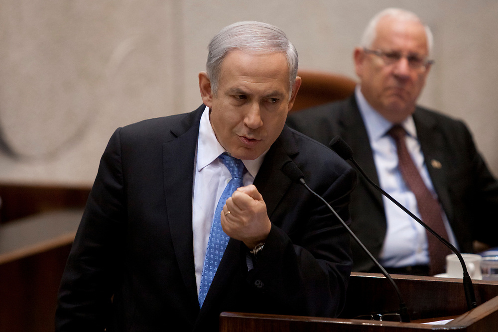 Israel's Prime Minister Benjamin Netanyahu (L) gestures as he speaks during a special session marking the International Holocaust Remembrance Day at the Knesset, Israel's parliament in Jerusalem, on January 24, 2012. Friday marks the International Holocaust Remembrance Day which is designated by the United Nations General Assembly to commemorate the victims of Holocaust.