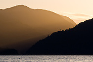 Power lines at sunset over Harrison Lake near Harrison Hot Springs, British Columbia, Canada