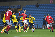 Oxford United midfielder Marcus McGuane (18) controls the ball during the EFL Sky Bet League 1 match between Oxford United and Swindon Town at the Kassam Stadium, Oxford, England on 28 November 2020.
