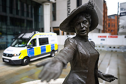 © Licensed to London News Pictures . 02/10/2021. Manchester, UK. Police are seen parked behind a statue of suffragette Emmeline Pankhurst in St Peter's Square , in Manchester City Centre , on the eve of the Conservative Party Conference . The Conservative Party Conference takes place at the Manchester Central Exhibition Centre from tomorrow (3rd October 2021). Photo credit: Joel Goodman/LNP