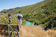 Cyclists touring the Gibbston Valley, South Island, New Zealand