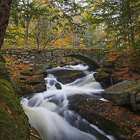 This fall I returned to New Hampshire for another exquisite waterfalls photography adventure. Gleason Falls with its cobble stone arch bridge and the wild Beard Brook made for a great outdoor photography subject. New England fall colors were still imminent, and I was able to frame the rushing brook and waterfall scene with them. An overcast sky beautifully balanced the light and New Hampshire scenery. <br /> <br /> New Hampshire waterfall photography images are available as museum quality photography prints, canvas prints, acrylic prints or metal prints. Prints may be framed and matted to the individual liking and decorating needs at:<br /> <br /> https://juergen-roth.pixels.com/featured/gleason-falls-juergen-roth.html<br /> <br /> All high resolution New Hampshire photography images are available for photo image licensing at www.RothGalleries.com. Please contact me direct with any questions or request. <br /> <br /> Good light and happy photo making!<br /> <br /> My best,<br /> <br /> Juergen<br /> Prints: http://www.rothgalleries.com<br /> Photo Blog: http://whereintheworldisjuergen.blogspot.com<br /> Instagram: https://www.instagram.com/rothgalleries<br /> Twitter: https://twitter.com/naturefineart<br /> Facebook: https://www.facebook.com/naturefineart