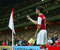 Photo: Chris Ratcliffe.<br /> Arsenal v Dinamo Zagreb. UEFA Champions League, Qualifying. 23/08/2006.<br /> Cesc Fabregas of Arsenal shows a coin to the ref that was thrown in his direction by Zagreb fans.