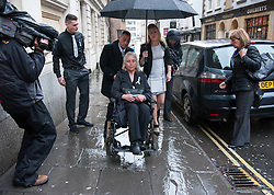 © Licensed to London News Pictures. 13/11/2015. Bristol, UK.  DARREN GALSWORTHY the father of murder victim Rebecca Watts, wheels his wife ANJIE GALSWORTHY, the mother of Nathan Matthews who is accused of Becky Watts' murder, into Bristol Crown court on the day Nathan Matthews the son of Anjie is sentenced for the murder of Rebecca Watts the daughter of Darren.  Photo credit : Simon Chapman/LNP