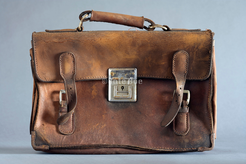 old weathered leather briefcase