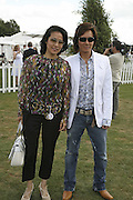 Patti and Andy Wong, Cartier International Polo. Guards Polo Club. Windsor Great Park. 30 July 2006. ONE TIME USE ONLY - DO NOT ARCHIVE  © Copyright Photograph by Dafydd Jones 66 Stockwell Park Rd. London SW9 0DA Tel 020 7733 0108 www.dafjones.com