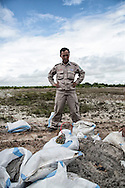 With the help of the RENEW project (Restoring the Environment and Neutralizing the Effects of the War) and Norwegian People's Aid, a bomb-disposal expert is about to destroy a UXO (Unexploded Ordnance), Quang Tri Province, Vietnam, Southeast Asia
