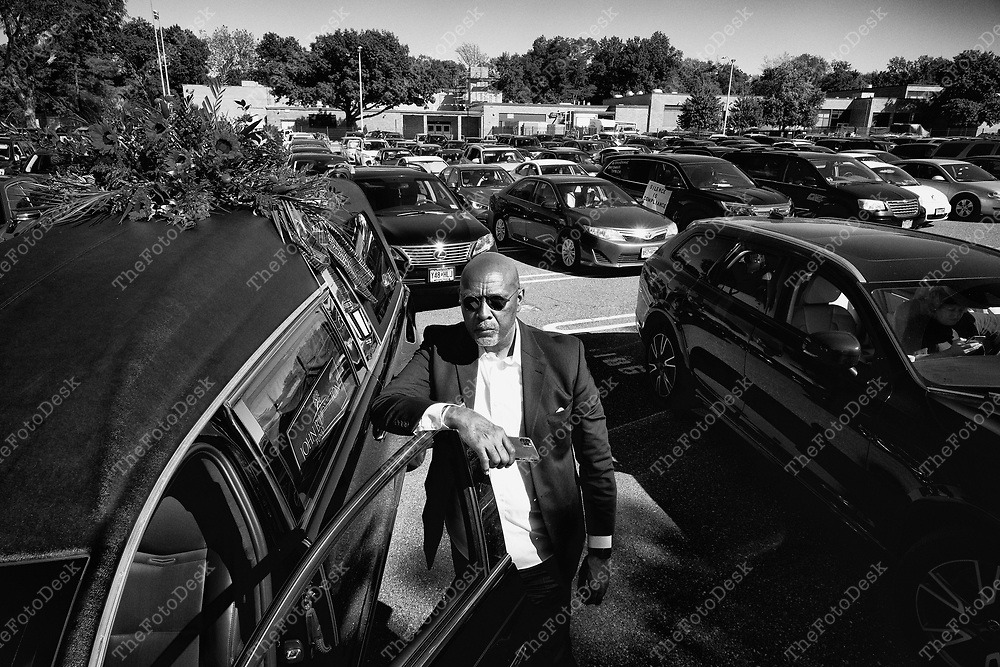 """SUMMIT, NEW JERSEY: Funeral Director John Houston, Plainfield leads a 300 car motorcade in honor of the Blacks Lives Matter Movement for George Floyd and others who have fallen by the hands of the police during a mock processional through the streets of Summit, New Jersey on Sunday, June 14, 2020 The Motorcade passed passed by 12 religious organizations, synagogues and churches who also pay tribute to the fallen """"officials said.""""(Brian Branch-Price/TheFotoDesk)."""