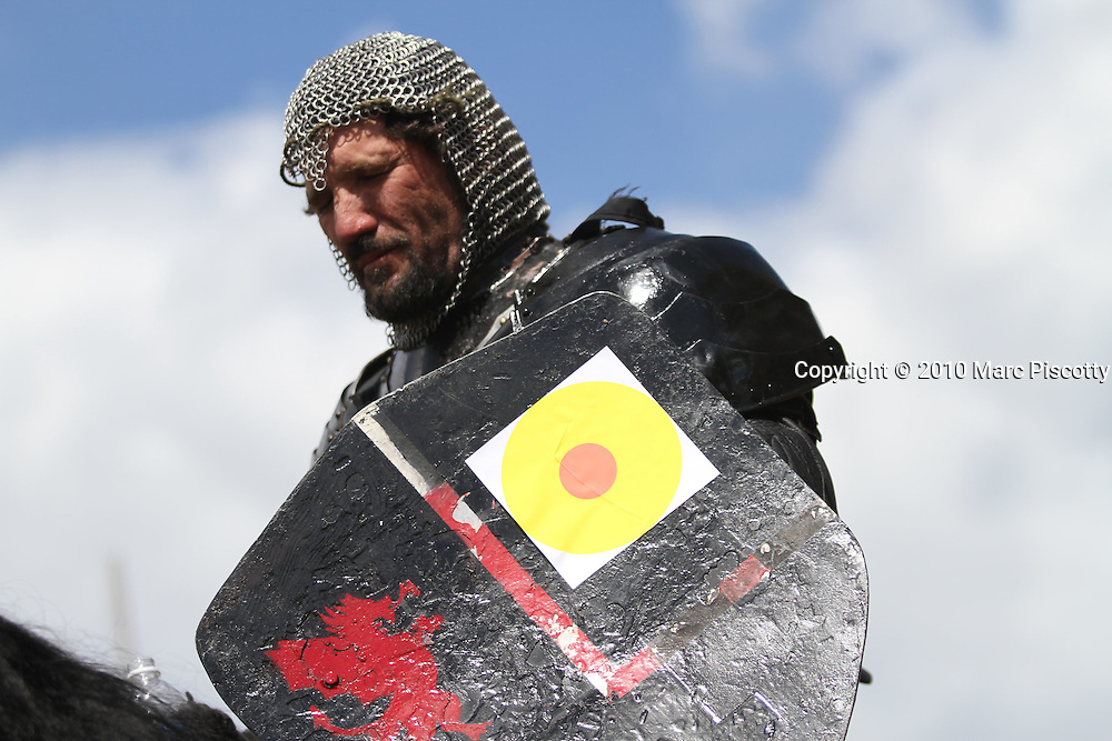 """SHOT 9/10/10 12:54:43 PM - Jousting events at the Longs Peak Scottish-Irish Highland Festival in Estes Park, Co. on Friday September 10, 2010. Heavy armor jousting was prominent in the 15th and 16th centuries. Each competitor tries to dislodge their opponent from their horse. In light armor jousting the purpose of this competition is for the competitor to strike his opponent's shield at a designated spot. This jousting was popular in the 12th and 13th century. Jousting in its basic form is a martial contest between two knights mounted on horses and using lances. The skills used in tournaments were a reflection of the martial skills applied to battle where the primary purpose was to try to kill or disable an opponent. The primary purpose of the jousting lance  is to unhorse the other by striking them with the end of the lance while riding towards them at high speed. This is known as """"tilting"""". (Photo by Marc Piscotty / © 2010)"""