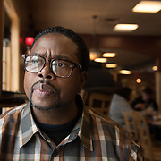 Date: 2/20/15<br /> Desk: SCI<br /> Slug: SUPER UTILIZERS<br /> Assign Id: 30171269A<br /> <br /> Jerome Pate, 51, who has been homeless and has struggled with addiction, sits for a portrait in the Blackwater Coffee Company & Cafe, near a group house where he is living while in a 6-month addiction treatment program in Maple Plain, Minnesota on February 20, 2015. Mr. Pate has been part of a program in Hennepin County designed to get him better medical care and services. <br /> <br /> Photo by Angela Jimenez for The New York Times <br /> photographer contact 917-586-0916