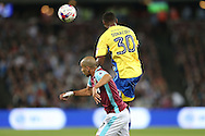 Janoi Donacien of Accrington Stanley heads the ball over Sofiane Feghouli of West Ham United. EFL Cup, 3rd round match, West Ham Utd v Accrington Stanley at the London Stadium, Queen Elizabeth Olympic Park in London on Wednesday 21st September 2016.<br /> pic by John Patrick Fletcher, Andrew Orchard sports photography.