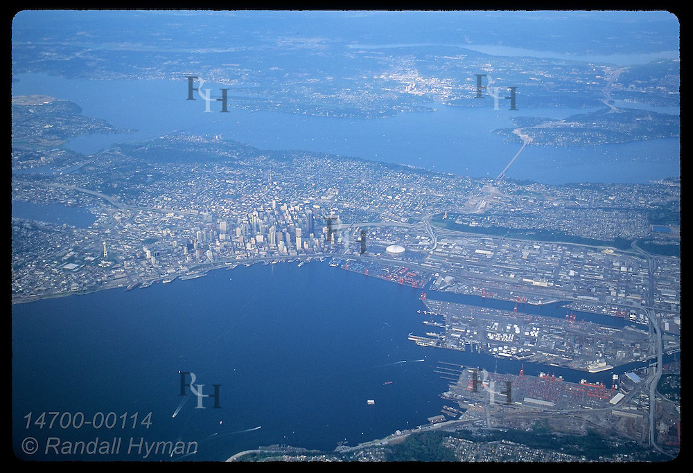 Aerial view of downtown shows Puget Sound and Lake Washington on a summer afternoon; Seattle. Washington