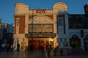 People enjoying the afternoon sun at the Ritzy cinema on the 25th February 2019 in Brixton in the United Kingdom. The Ritzy is a multiple screen restored cinema dating back to 1911 with a cafe and bar.