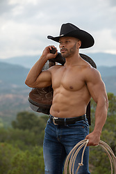 muscular black cowboy on a mountain range