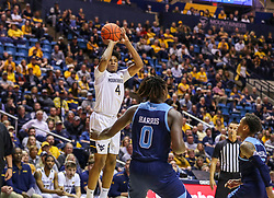 Dec 1, 2019; Morgantown, WV, USA; West Virginia Mountaineers guard Miles McBride (4) shoots a three pointer during the second half against the Rhode Island Rams at WVU Coliseum. Mandatory Credit: Ben Queen-USA TODAY Sports