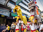 """19 FEBRUARY 2015 - BANGKOK, THAILAND: Lion dancers perform for Chinese New Year in Bangkok. 2015 is the Year of Goat in the Chinese zodiac. The Goat is the eighth sign in Chinese astrology and """"8"""" is considered to be a lucky number. It symbolizes wisdom, fortune and prosperity. Ethnic Chinese make up nearly 15% of the Thai population. Chinese New Year (also called Tet or Lunar New Year) is widely celebrated in Thailand, especially in urban areas that have large Chinese populations.    PHOTO BY JACK KURTZ"""
