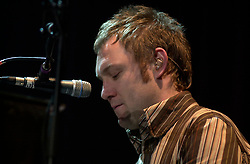 David Grey plays a Concert to a sellout Sheffield Hallam FM Arena  November 29 2002 Friday<br /><br />Copyright Paul David Drabble<br />Freelance Photographer<br />07831 853913<br />0114 2468406<br />www.pauldaviddrabble.co.uk<br /> [#Beginning of Shooting Data Section]<br />Nikon D1 <br /> 2002/11/29 21:47:22.1<br /> JPEG (8-bit) Fine<br /> Image Size:  2000 x 1312<br /> Color<br /> Lens: 80-200mm f/2.8-2.8<br /> Focal Length: 155mm<br /> Exposure Mode: Manual<br /> Metering Mode: Spot<br /> 1/200 sec - f/2.8<br /> Exposure Comp.: 0 EV<br /> Sensitivity: ISO 400<br /> White Balance: Auto<br /> AF Mode: AF-S<br /> Tone Comp: Normal<br /> Flash Sync Mode: Not Attached<br /> Color Mode: <br /> Hue Adjustment: <br /> Sharpening: Normal<br /> Noise Reduction: <br /> Image Comment: <br /> [#End of Shooting Data Section] David Grey plays a Concert to a sell out Sheffield Hallam FM Arena November 29 2002 Friday<br /> <br /> Copyright Paul David Drabble<br /> Freelance Photographer<br /> 07831 853913<br /> 0114 2468406