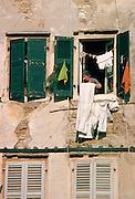 A woman hanging out washing in Corfu.