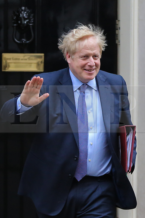 © Licensed to London News Pictures. 05/02/2020. London, UK. British Prime Minister BORIS JOHNSON departs from Number 10 Downing Street to attend Prime Minister's Questions (PMQs) in the House of Commons. Photo credit: Dinendra Haria/LNP