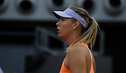 May 8, 2017 - Madrid, Spain - Maria Sharapova of Russia plays a forehand in her match against Eugenie Bouchard of Canada pass at the net in their match during day three of the Mutua Madrid Open tennis at La Caja Magica on May 8, 2017 in Madrid, Spain. (Credit Image: © Oscar Gonzalez/NurPhoto via ZUMA Press)