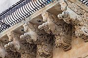 Ancient stone mythical horses and gargoyles on Palazzo Nicolaci di Valladorata in Baroque Noto city, Sicily