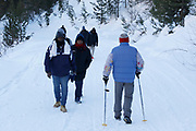 Abdullhai, 38 (L), and Abdurahman, migrants from Guinea walk along with another group as they pass an Italian man during an attempt to cross part of the Alps mountain range from Italy into France, near the town of Bardonecchia in northern Italy.