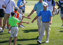 March 31, 2018 - Humble, TX, U.S. - HUMBLE, TX - MARCH 31:  Ryan Armour (USA) fist bumps with fans on the way to tee box on 3 during Round 3 of the Houston Open on March 31, 2018 at Golf Club of Houston in Humble, Texas.  (Photo by Leslie Plaza Johnson/Icon Sportswire) (Credit Image: © Leslie Plaza Johnson/Icon SMI via ZUMA Press)