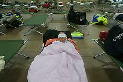 August 26, 2017 - San Antonio, Texas, U.S. - First responders get some rest Saturday in a building near the Freeman Expo Hall as Hurricane Harvey passes through San Antonio. The area is a staging hub for emergency personnel from all over the United States and is a temporary home for emergency wokers from Texas, Missouri, Ohio, Utah and other states. The storm is moving to the north and appears to be weakening. (Credit Image: © San Antonio Express-News via ZUMA Wire)