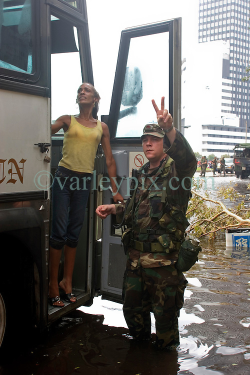 01 Sept, 2005. New Orleans, Louisiana.<br /> Mass evacuation begins. Room for 2 more on the bus. Exhausted former residents of the Superdome 'shelter of last resort' wade through flood water to get to the first busses evacuating people from New Orleans to destinations unknown.<br /> Photo©; Charlie Varley/varleypix.com