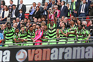 Forest Green Rovers Shamir Mullings(18) lifts the trophy during the Vanarama National League Play Off Final match between Tranmere Rovers and Forest Green Rovers at Wembley Stadium, London, England on 14 May 2017. Photo by Shane Healey.