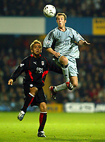 Photograph: Scott Heavey.<br />Fulham v Newcastle Utd. FA Barclaycard Premiership. 21/10/2003.<br />Lee Bowyer takes the ball from the grasp of Junichi Inamoto