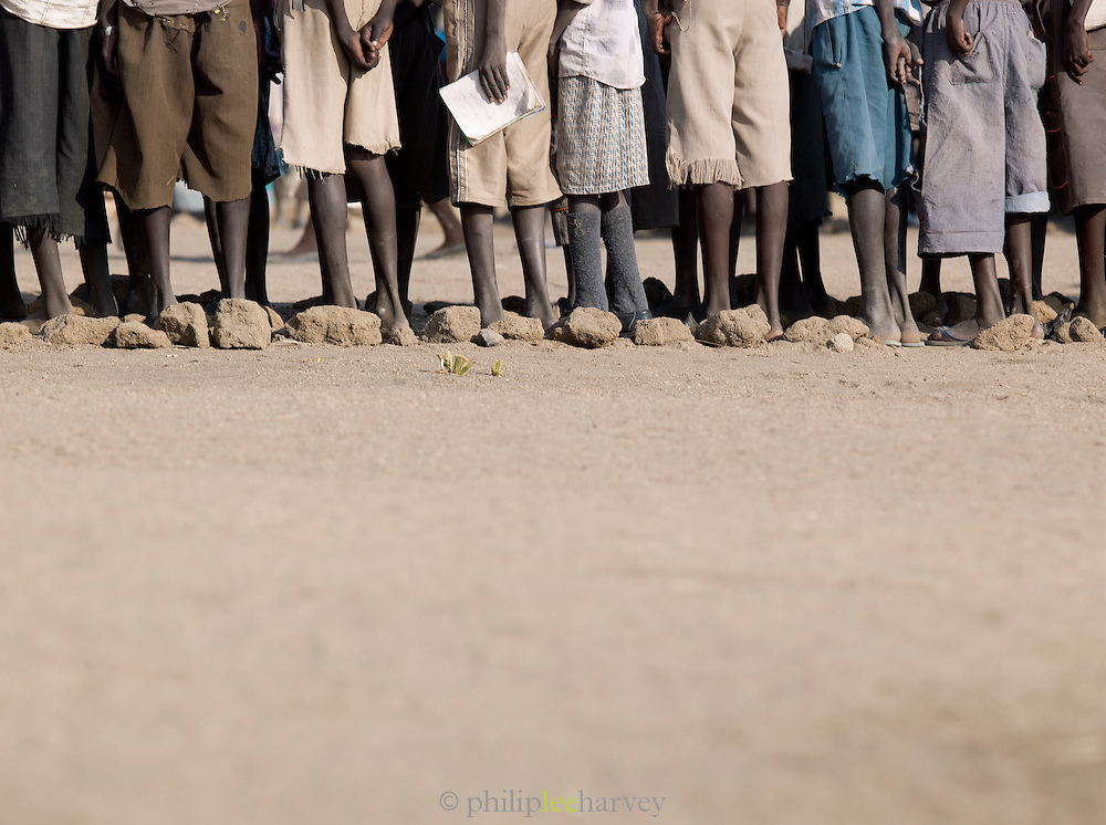 Children of the Nuba tribe lined up ready for school in the village of Nyaro, Kordofan region, Sudan