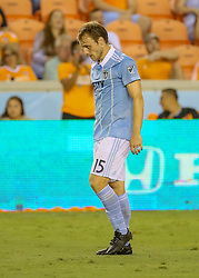 August 4, 2018 - Houston, TX, U.S. - HOUSTON, TX - AUGUST 04:  Sporting Kansas City defender Seth Sinovic (15) walks away after receiving a yellow card during the soccer match between Sporting Kansas City and Houston Dynamo on August 4, 2018 at BBVA Compass Stadium in Houston, Texas.  (Photo by Leslie Plaza Johnson/Icon Sportswire) (Credit Image: © Leslie Plaza Johnson/Icon SMI via ZUMA Press)