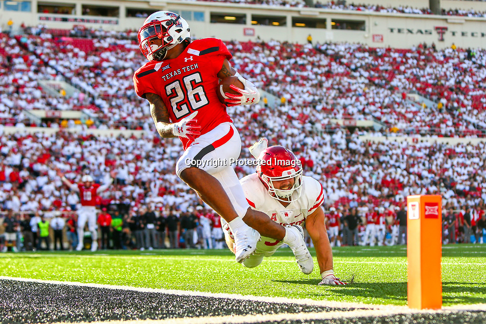 Texas Tech running back Ta'Zhawn Henry (26) runs for a touchdown against Houston on Saturday, Sept. 15, 2018, at Jones AT&T Stadium in Lubbock, Texas. [John Moore/A-J Media]