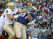 Washington's Johnie Kirton (37) misses a pass in the endzone under pressure from Notre Dame's Tom Zbikowski. (AP Photo/John Froschauer)