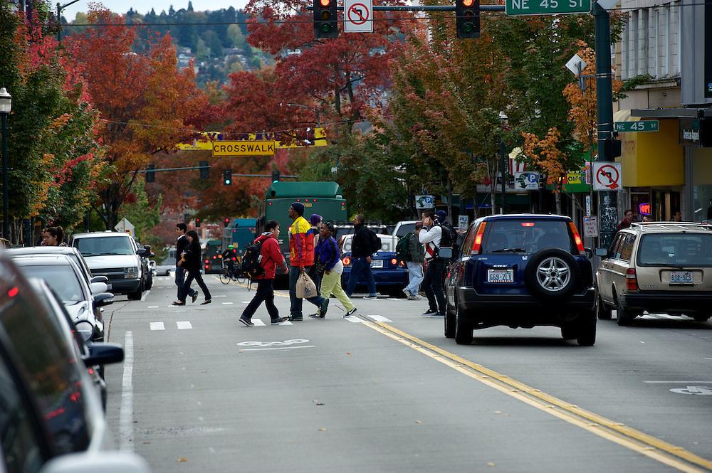 2010 October 27 -  Pedestrians cross through traffic at NE 45th Street along University Way near the University of Washington, Seattle, WA. CREDIT: Richard Walker