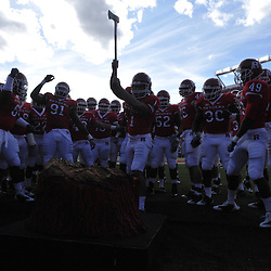 Oct 10, 2009; Piscataway, NJ, USA; Rutgers kicker San San Te (1) chops the axe into the Scarlet Chop Block at Rutgers Stadium before first half NCAA college football action between Rutgers and Texas Southern at Rutgers Stadium.