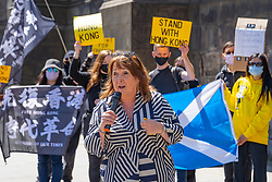 Edinburgh, Scotland, UK. 1 July  2021. On the 1 July which is the 100th anniversary of the founding of the Chinese Communist Party, Hong Kong pro democracy protesters held a rally at St Giles Cathedral on the Royal Mile in Edinburgh. Guest speaker Christine Jardine MSP liberal democrat, voiced her support and urged the UK Government to offer UK visas for all Hong Kong people. Pic; MSP Christine Jarvie makes speech in support of the Hong Kong democracy movement. Iain Masterton/Alamy Live News