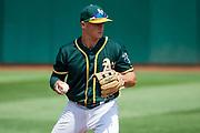 Oakland Athletics third baseman Matt Chapman (26) fields a ball against the Los Angeles Angels at Oakland Coliseum in Oakland, California, on September 6, 2017. (Stan Olszewski/Special to S.F. Examiner)