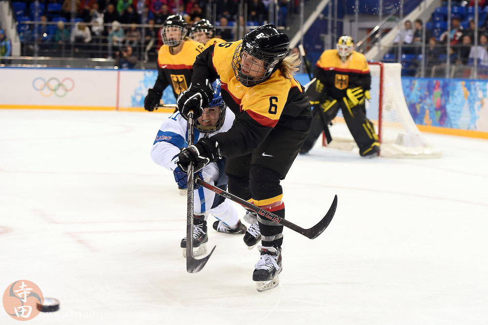 Feb 16, 2014; Sochi, RUSSIA; Germany forward Bettina Evers (6) controls the puck against Finland forward Annina Rajahuhta (11) in the women's ice hockey classifications round during the Sochi 2014 Olympic Winter Games at Shayba Arena.